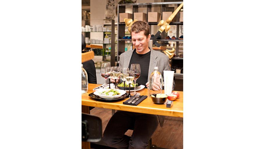 Matthew Malin tasting the wine.