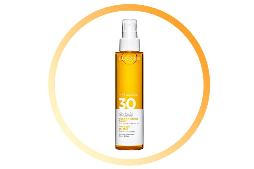 Солнцезащитное масло-спрей для тела иволос Huile-en-Brume Solaire SPF 30, Clarins